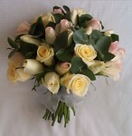 Hand-tied bridal bouquet of cream and pale pink roses and australian native spinning gum