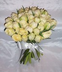 Hand-tied wedding bouquet of cream roses and ivory tulips