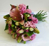 Hand-tied bridal bouquet of dusty pink lilies and pink lisianthus
