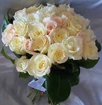 Hand-tied wedding bouquet of ivory and pale pink roses