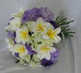 Hand-tied bridal bouquet of ivory spray roses frangipanis and mauve lisianthus