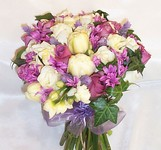 Hand-tied bridal bouquet of ivory tulips purple roses and purple hyacinths