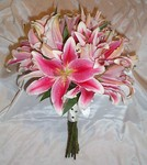 Wired bridal bouquet of pink star-gazer lilies