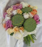 Hand-tied rose wedding bouquet featuring green lotus pods